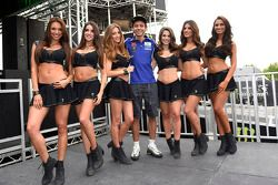 Valentino Rossi, with lovely paddock girls