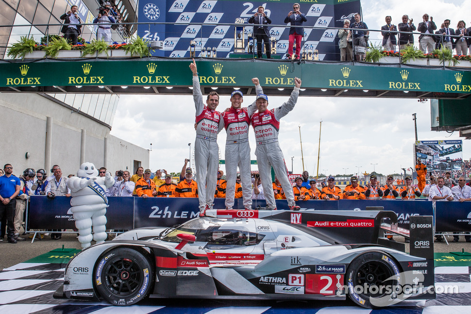 Overall race winners Benoit Tréluyer, Andre Lotterer and Marcel Fässler celebrate
