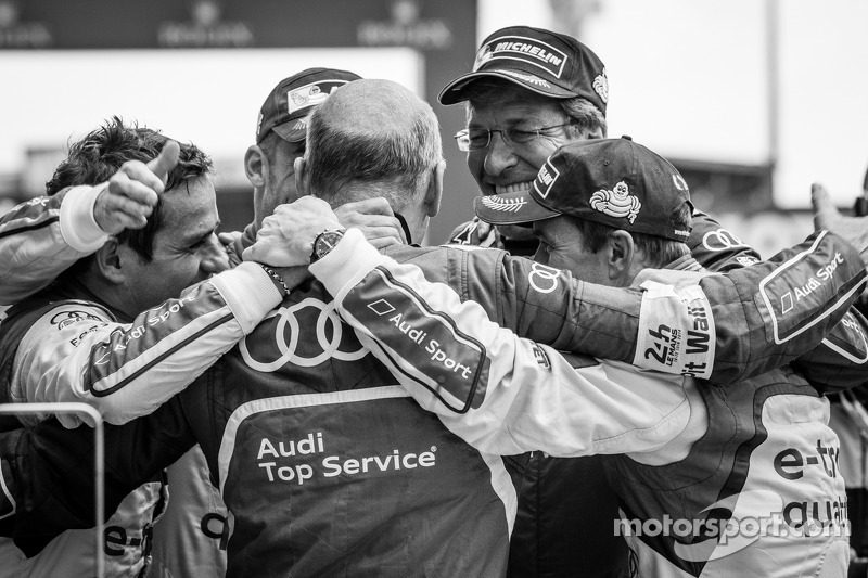 Overall race winners Benoit Tréluyer, Andre Lotterer and Marcel Fässler celebrate with Dr. Wolfgang
