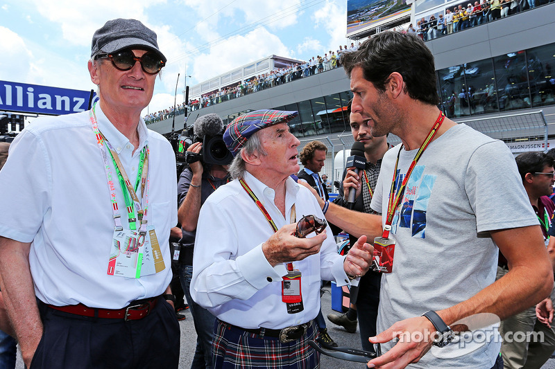 (L to R): Sir James Dyson, Inventor, with Jackie Stewart, and Mark Webber, Porsche Team WEC Driver on the grid
