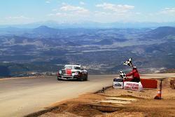 Romain Dumas waits at the summit
