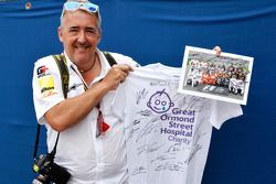 Mark Sutton of Sutton Images poses with signed memorabilia for the Great Ormond Street Hospital char