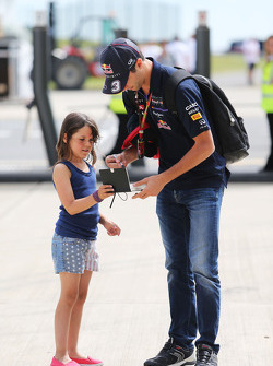 Daniel Ricciardo, Red Bull Racing signs an autograph for a young fan