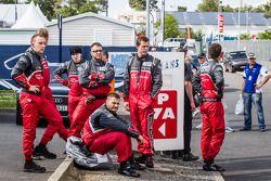 Audi Sport Team Joest team members wait for the crashed #1 Audi Sport Team Joest Audi R18 E-Tron Quattro