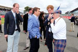Mark Stewart; HRH Prince Harry, and Jackie Stewart, on the grid