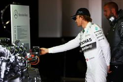 Nico Rosberg, Mercedes AMG F1 looks at a road-going Mercedes engine on display in the pits