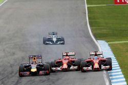 (L to R): Sebastian Vettel, Red Bull Racing RB10, Kimi Raikkonen, Ferrari F14-T and Fernando Alonso, Ferrari F14-T battle for position