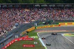 Pastor Maldonado, Lotus F1 E21 leads Kamui Kobayashi, Caterham CT05 and Kevin Magnussen, McLaren MP4-29