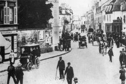 Racing amongst horses and pedestrians on a busy street in Mantes-la-Ville en route to Rouen