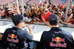 Sebastian Vettel, Red Bull Racing and team mate Daniel Ricciardo, Red Bull Racing sign autographs fo