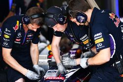 Red Bull Racing RB10 worked on by mechanics