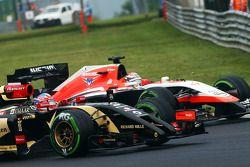 Romain Grosjean, Lotus F1 E22 and Jules Bianchi, Marussia F1 Team MR03 battle for position