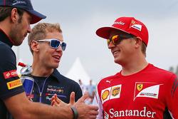 Jean-Eric Vergne, Scuderia Toro Rosso; Sebastian Vettel, Red Bull Racing; y Kimi Raikkonen, Ferrari