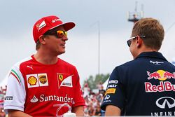 Kimi Raikkonen, Ferrari and Sebastian Vettel, Red Bull Racing on the drivers parade.