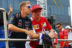 Sebastian Vettel, Red Bull Racing and Kimi Raikkonen, Ferrari on the drivers parade.