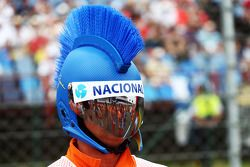 A marshal with a mohican Ayrton Senna themed helmet.