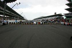 Race winner Jeff Gordon kisses the yard of Bricks