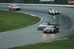 Mike Skeen, Audi R8 and Ryan Dalziel, Porsche 911 GT3 battle for the lead.