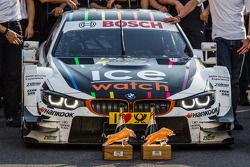 The winning BMW Team RMG BMW M4 DTM of Marco Wittmann and its trophies