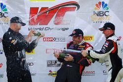 GT-A class winners champagne: Albert v T u Taxis (eft), Michael Mills (center), Jim Taggart (right)