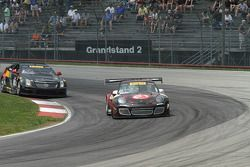 Ryan Dalziel, Porsche 911 GT3 and Johnny O'Connell, Cadillac CTS-V.R battle for the lead
