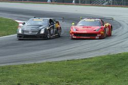 Anthony Lazzaro, Ferrari 458 GT3 and Andy Pilgrim, Cadillac CTS-V.R fight through turn 4