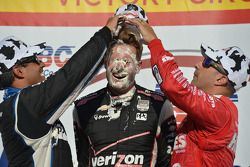 Race winner Will Power gets a face full of cream puff from second place Juan Pablo Montoya and third