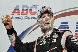 Race winner Will Power gets a face full of cream puff