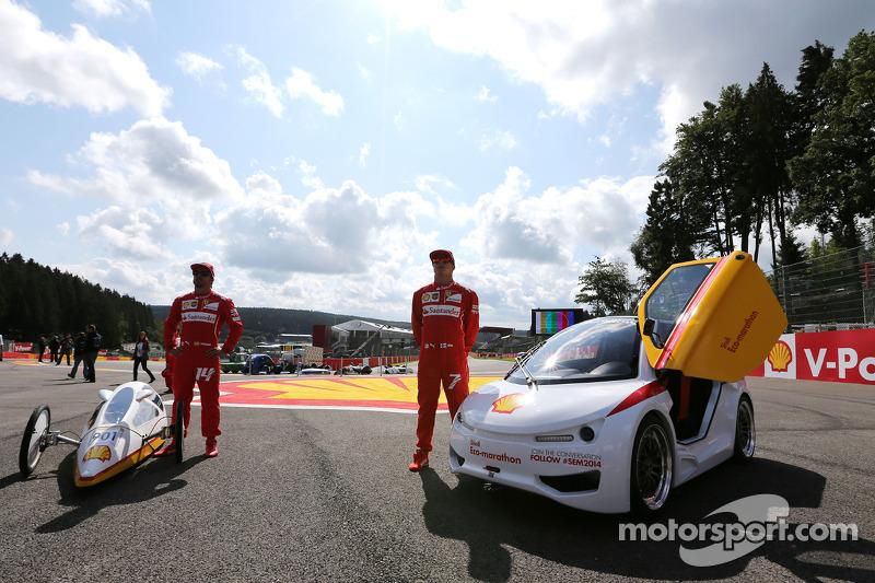 Fernando Alonso, Scuderia Ferrari and Kimi Raikkonen, Scuderia Ferrari drives a car from the Shell E