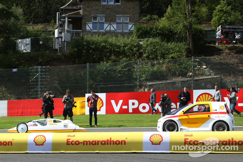 (L to R): Fernando Alonso, Ferrari and team mate Kimi Raikkonen, Ferrari drive cars from the Shell Eco Marathon