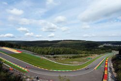 Daniel Ricciardo, Red Bull Racing RB10 leads Fernando Alonso, Ferrari F14-T