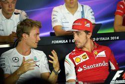 (L to R): Nico Rosberg, Mercedes AMG F1 and Fernando Alonso, Ferrari in the FIA Press Conference