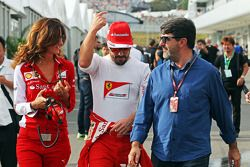 (L to R): Roberta Vallorosi, Ferrari Press Officer with Fernando Alonso, Ferrari and Luis Garcia Abad, Driver Manager