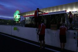 The Marussia F1 Team pit gantry at night time