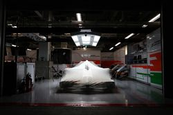 A Sahara Force India F1 VJM07 at night time in parc ferme conditions in the pit garage