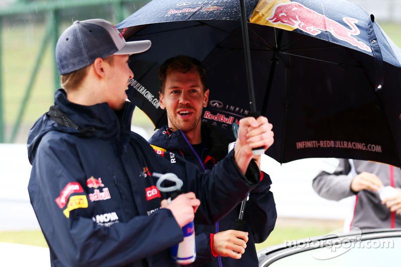 (L to R): Daniil Kvyat, Scuderia Toro Rosso and Sebastian Vettel, Red Bull Racing on the drivers par