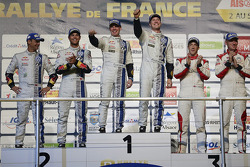 Podium: winners Jari-Matti Latvala and Miikka Anttila, second place Andreas Mikkelsen and Ola Floene, third place Kris Meeke and Paul Nagle