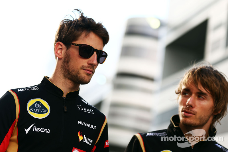 (L to R): Romain Grosjean, Lotus F1 Team with Charles Pic, Lotus F1 Team Third Driver