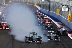Nico Rosberg, Mercedes AMG F1 locks up under braking beside team mate Lewis Hamilton, Mercedes AMG F1 W05 at the start of the race