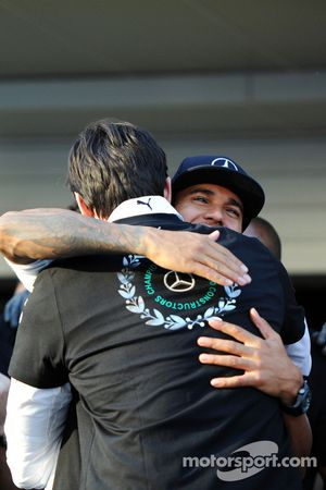 Lewis Hamilton, Mercedes AMG F1 celebrates winning the 2014 Constructors Championship with Toto Wolff, Mercedes AMG F1 Shareholder and Executive Director and the team
