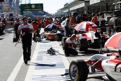 ART Grand Prix mechanic runs down the pit lane