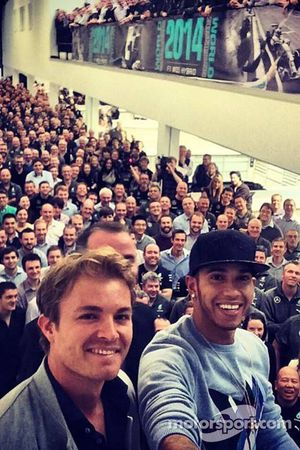 Nico Rosberg and Lewis Hamilton take a selfie with the Mercedes Factory Workers.