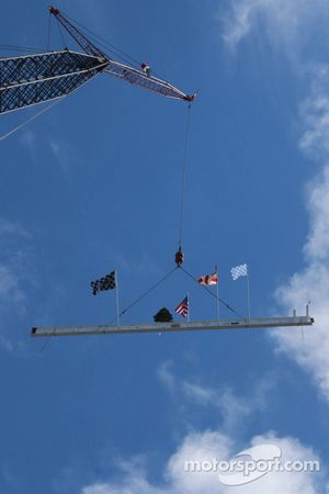 Highest beam is signed by workers and hoisted into position