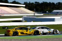 Timo Glock, BMW Team MTEK BMW M3 DTM en Nico Muller, Audi Sport Team Rosberg Audi RS 5 DTM