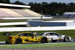 Timo Glock, BMW Team MTEK BMW M3 DTM and Nico Muller, Audi Sport Team Rosberg Audi RS 5 DTM