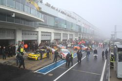 Cars in the pitlane after the red flag