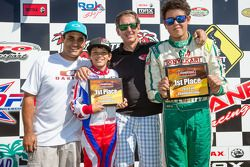 Juan Pablo Montoya with son Sebastian Montoya and Christian Munoz