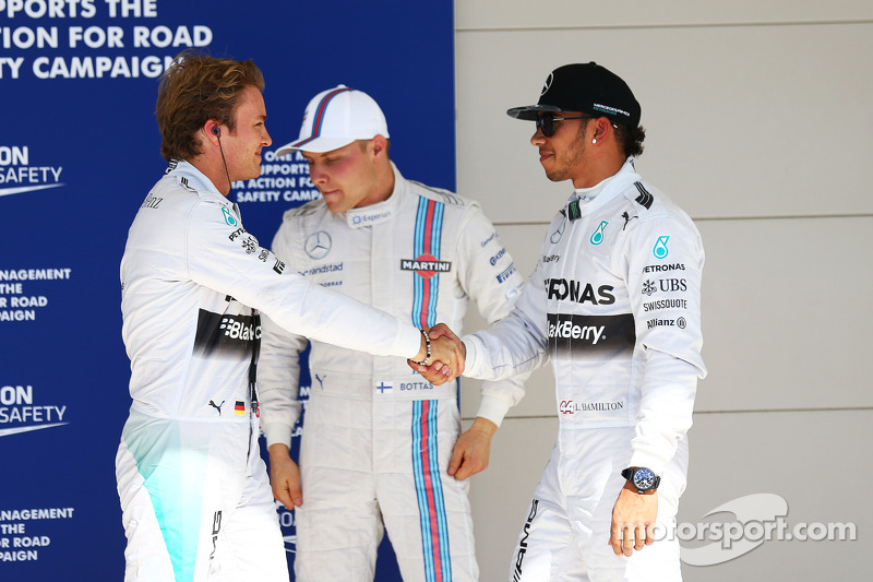 (L to R): Nico Rosberg, Mercedes AMG F1 celebrates his pole position in parc ferme with second placed team mate Lewis Hamilton, Mercedes AMG F1