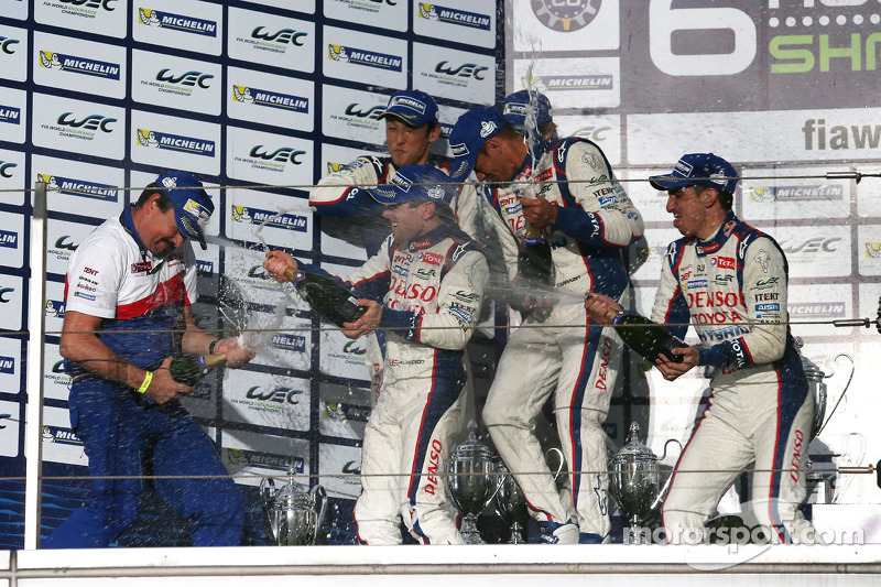 Toyota Hybrid team celebrates on the podium with champagne
