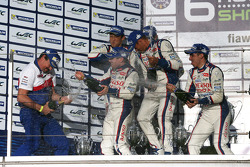 Toyota Hybrid team celebrates on the podium with champagne